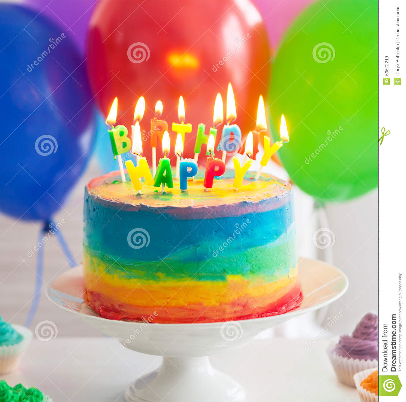 rainbow-cake-cupcakes-decorated-birthday-candles-balloons-background-50672219